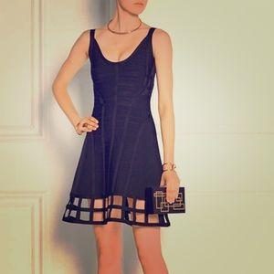 Herve Leger Black cage hem cut out dress